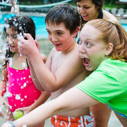 Campers and staff playing with water.