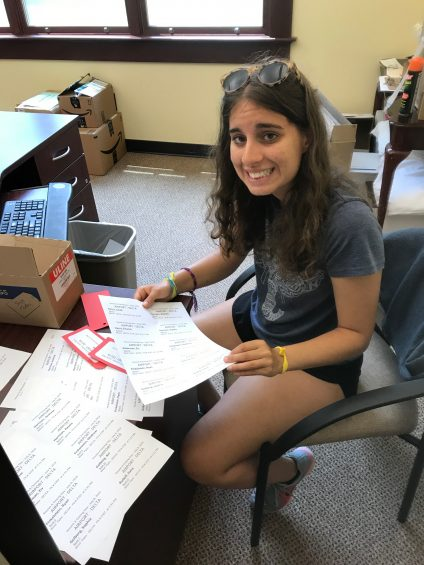 Smiling and looking at paperwork