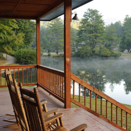 Picture of two rocking chairs on the Boathouse porch overlooking the lake a Ramah Darom