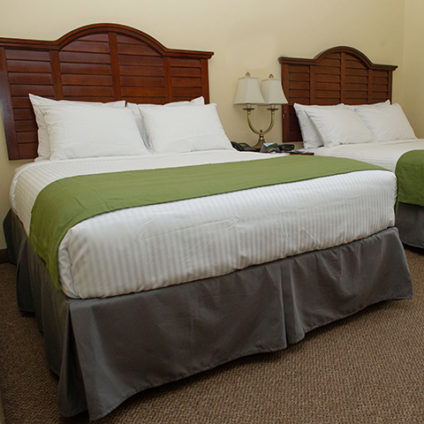 Picture of double queen beds in a deluxe hotel room at Ramah Darom