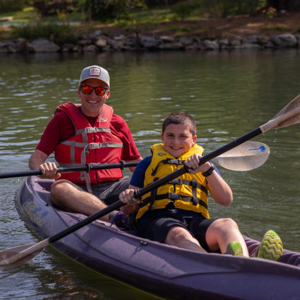 Picture of a son and father kayaking at Ramah Darom